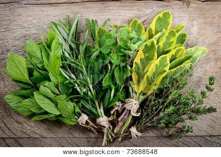 Bunch Of Fresh Herbs Wooden Background.