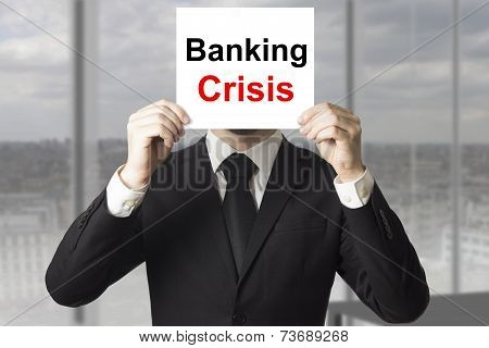 Businessman Hiding Face Behind Sign Banking Crisis