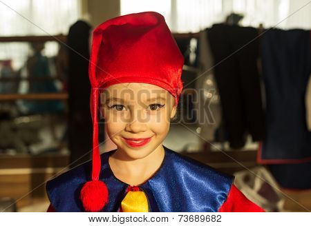 A nice happy kid wearing gnome clothes.