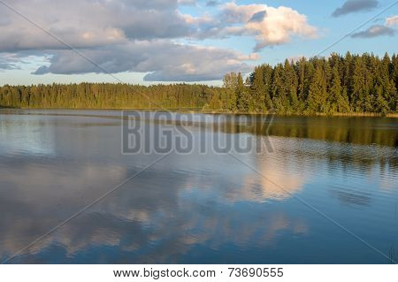 Sky And Clouds Reflection On Lake