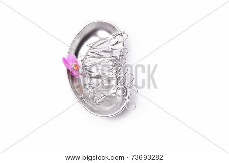 Orchid And Surgical Instruments On White