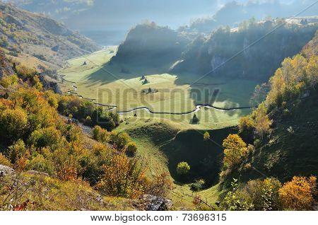 Autumn Mountain Landscape With A Small Meandering Water Stream