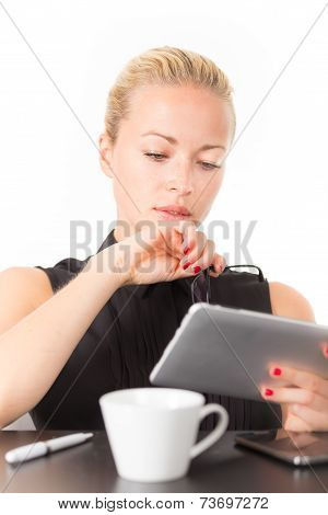 Business woman working on tablet PC.