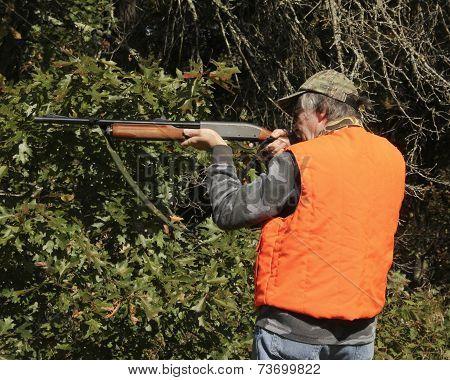 Hunter Pointing A Shotgun