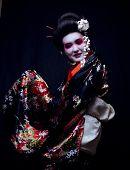 picture of geisha  - young pretty geisha in kimono with sakura and decoration - JPG