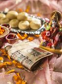 foto of indian currency  - Indian rupees bank notes in Diwali puja with a Goddess of wealth  - JPG