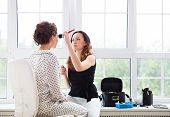 Постер, плакат: Make up Artist Doing Make Up For Young Beautiful Bride