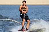 stock photo of watersports  - Wakeboarder riding in sunset - JPG