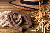foto of lasso  - American West still life with old horseshoe and cowboy lasso - JPG