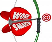 foto of productivity  - Work Smarter words on a bow and arrow aiming at a target as efficient productive working plan or strategy - JPG