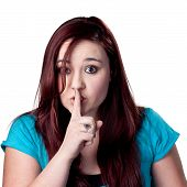stock photo of shh  - Fingers on lips woman tells people to be quiet - JPG