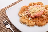 pic of shredded cheese  - waffle with sausace topping with shred cheese - JPG
