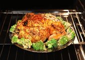 image of spit-roast  - appetizing roast turkey and potatoes in the oven - JPG