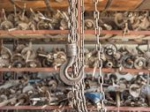 stock photo of hook  - chain and hook in garage  - JPG