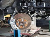 stock photo of assembly line  - Wheel and disc break in maintenance process - JPG