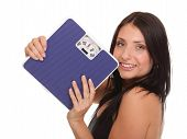 picture of scale  - Weight loss woman on scale happy on scales over white - JPG