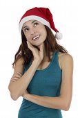 image of daydreaming  - Hopeful looking young christmas woman thinking and daydreaming - JPG