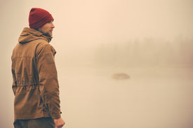 foto of boy scout  - Young Man standing alone outdoor with foggy scandinavian nature on background Travel Lifestyle and melancholy emotions concept film effects colors - JPG