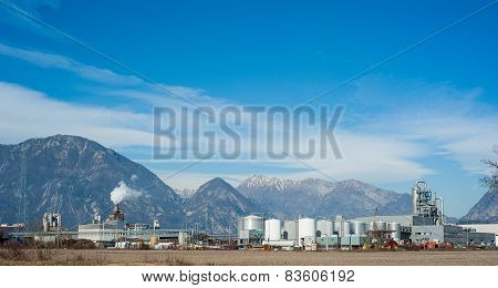 Industrial Plant With Behind The Italian Alps