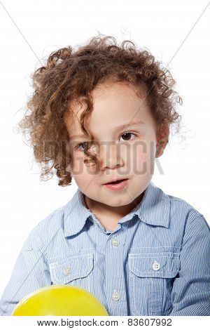 Adorable Curly Child In Casual Light Blue Shirt
