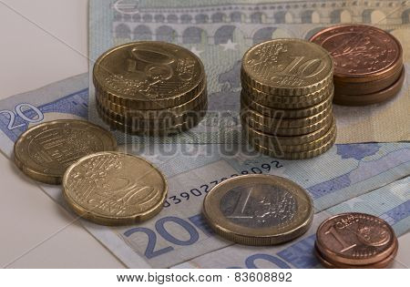 Euro Coins Stacked On Euro Bills