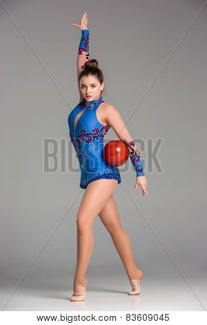 Teenager Doing Gymnastics Dance With Red Gymnastic Ball