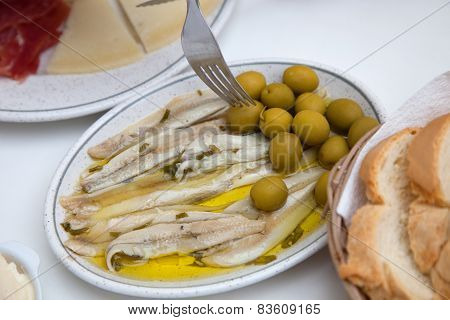 Fresh Fish Meat On White Plate With Olives