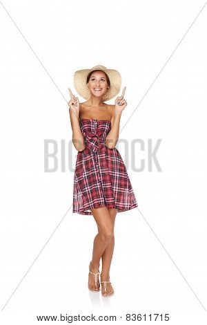 Happy young woman pointing up