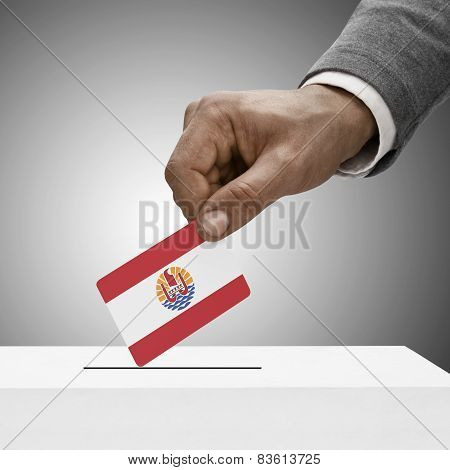Black Male Holding Flag. Voting Concept - French Polynesia