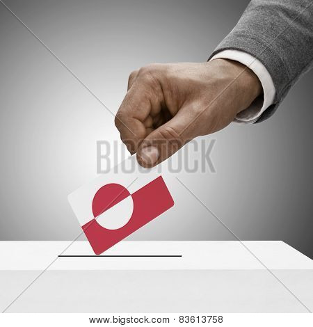 Black Male Holding Flag. Voting Concept - Greenland