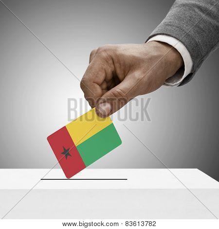 Black Male Holding Flag. Voting Concept - Guinea-bissau