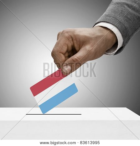 Black Male Holding Flag. Voting Concept - Luxembourg