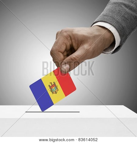 Black Male Holding Flag. Voting Concept - Moldova