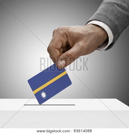 Black Male Holding Flag. Voting Concept - Nauru
