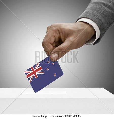 Black Male Holding Flag. Voting Concept - New Zealand