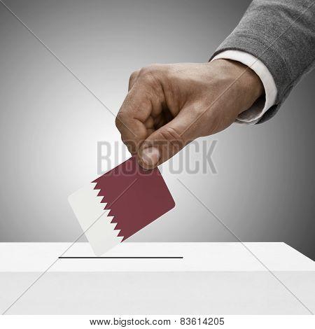 Black Male Holding Flag. Voting Concept - Qatar