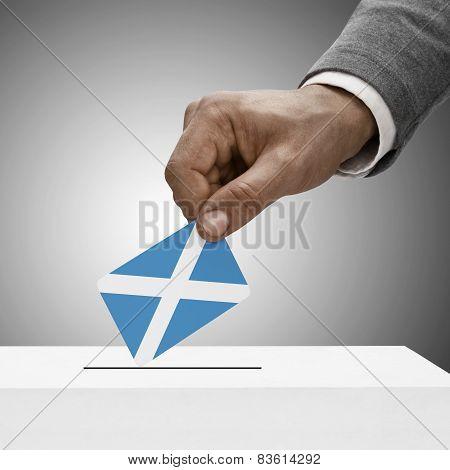 Black Male Holding Flag. Voting Concept - Scotland
