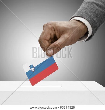 Black Male Holding Flag. Voting Concept - Slovenia