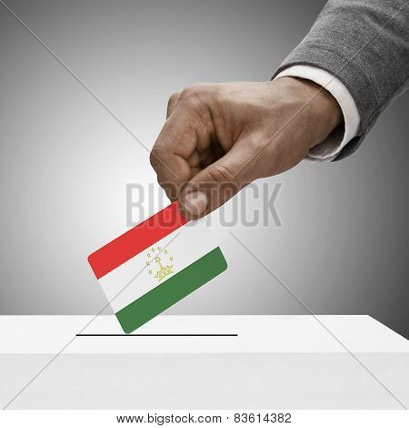 Black Male Holding Flag. Voting Concept - Tajikistan