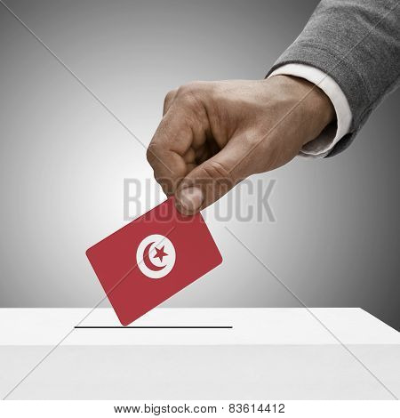 Black Male Holding Flag. Voting Concept - Tunisia