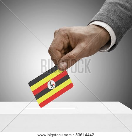 Black Male Holding Flag. Voting Concept - Uganda