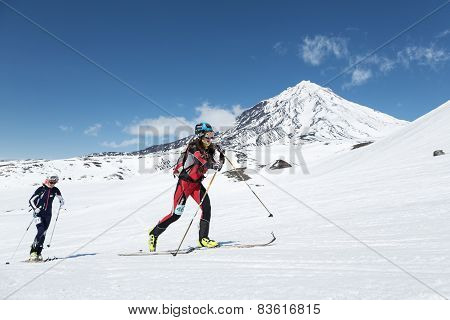 Ski Mountaineering Championships: Girl Ski Mountaineer Climb On Skis On Background Volcano