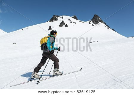 Ski Mountaineer Climb On Skis On Mountain