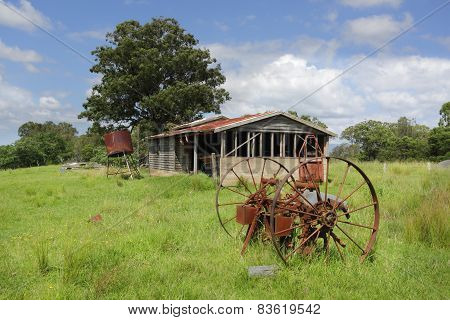 Old Derelict Farm Shed And Rusty Cart Wheels At Benandarah