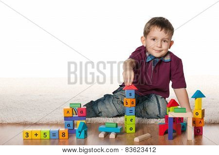 Little Boy Plays With Toys