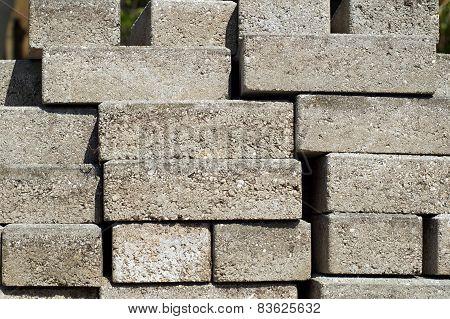 Stacked Building Bricks Outside In Sunshine
