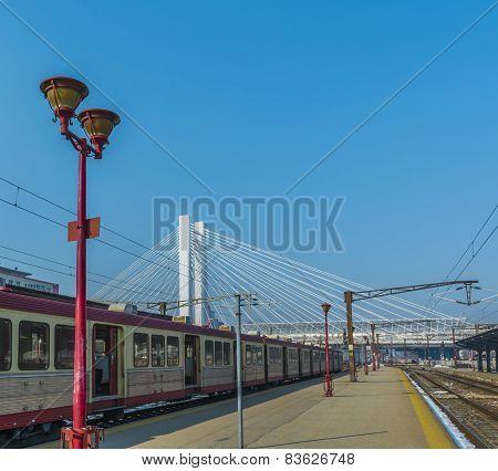 Passenger Train In Train Station Over A Nice White Bridge