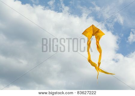flying yellow kite