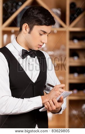 Waiter Making Notes.