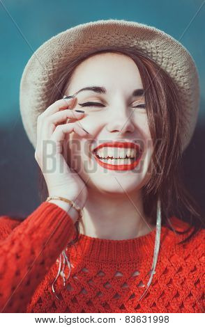 Young Beautiful Hipster Girl In Red Jersey With Hat Laughing